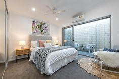 This smaller master bedroom has quite a bit with a long built in robe and ensuite along with a small private court yard and stacker doors. Home Decor Bedroom, Bedroom Wall, Master Bedroom, Bedroom Inspo, Bedroom Inspiration, Bedroom Ideas, Dark Grey Carpet Bedroom, Bedroom Carpet, Carpet Trends
