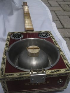 how to build a hubcap guitar