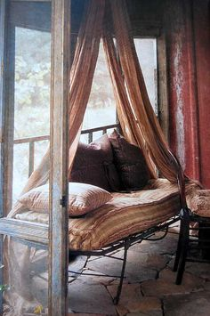 I want to curl up here with a good book and listen to the rain.