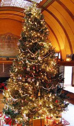 Frank Lloyd Wright Home and Studio: The playroom tree with candles. | For a similar look, decorate your Christmas tree branches with unlit real candles or LED candles. Give a nod to past fire precautions by nestling an empty pail under the tree with the gifts