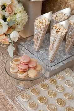 1920's themed dessert table with gold macarons and cookies - so sweet!