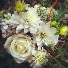 Bridesmaid bouquet. i like the texture here. we could do the white roses and add some green in there to give it depth