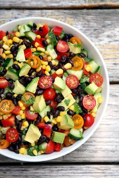 This cucumber, black bean, corn, tomato, and avocado salad will become your new fave Summer recipe. It's just 275 calories.