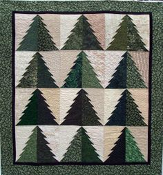"Into the Woods, 50 x 61"", pattern by Connie Ewbank at  Butterfly Stitches.  The blocks on this quilt are strip pieced and measure 7"" x 12"".  By creating right hand and left hand blocks, the top becomes covered with tessellating trees."