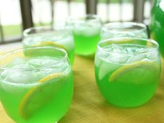 Green Punch ~ Two 13-ounce Packets Unsweetened Lemon-Lime Drink Mix, such as Kool-Aid, 2 cups Sugar, One 46-ounce Can Pineapple Juice, 12 ounces Frozen Lemonade Concentrate, thawed, 32 ounces Ginger Ale