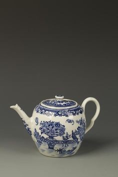 "Lot 235 - A WORCESTER TEAPOT AND COVER, blue printed with the ""Bat"" pattern, blue faux Chinese mark, circa 1775, 4.75"" high"