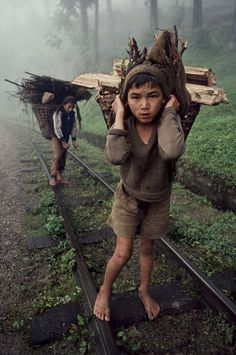 This was a photo by an American photographer Steve McCurry who is world famous for his photographer. I love how he has blurred out the background and the other little boy, this keeps my attention on the boy in the front of the picture. I also love the greens and grey tones in the photographer and how we can see the train track moving away from us and going around the corner.
