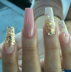 Long nails are beautiful. Gold design.