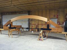 Curved truss assembled in a shop to check the fitting with steel tention rod.