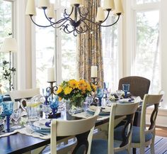 Summery Cottage Dining Room    A fresh blue and yellow table setting coordinates with patterned linen drapes.