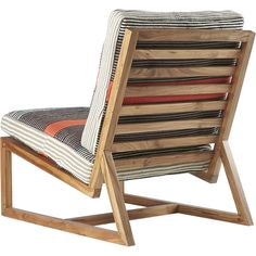 Shop sidi lounge chair.   Wood lounger leans back in time and space on slim acacia Danish-style frame.  Loose dhurrie cotton cushions retro vibe in wide, retro stripes of orange, grey, cream and turquoise comfortably support hours of downtime.