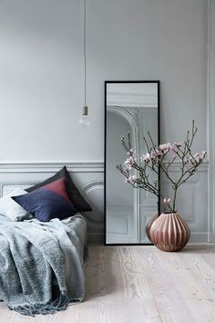 Soft neutrals| Pendant lighting, vase, rhododendron, floor mirror