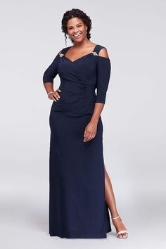 2d3e17c1c931c This sleek plus-size jersey sheath gown stays on-trend with  crystal-accented cold shoulder details. Side ruching and a faux-surplice  neckline provide ...