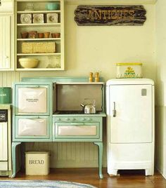 Not to give away my age but I remember this type of stove and ice box (not refrigerator).  The bread box was a common commodity in kitchens when I was young.