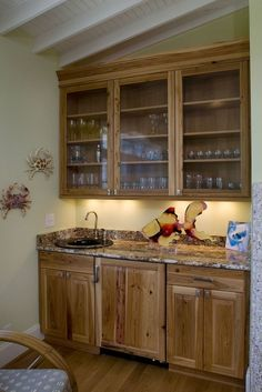 it can grow in scope to a more elaborate wraparound wet bar with cabinets microwave