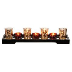 This beautiful set of glass tea-light candle holders (which includes the votives and tray) only looks luxe. $10 at Family Dollar