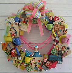 a wreath made of vintage figurines, party and circus memorabilia, toy blocks, old cake decorations etc etc.... GREAT IDEA especially for collectors.