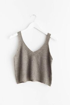 "Olive sleeveless sweater knitted tank top with a cropped fit. Size small measures approx. 17"" in length.  60% Cotton 40% Acrylic Imported"
