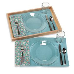 Table setting placemat with outlines of utensils and dinner ware.