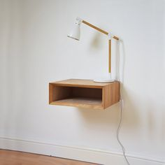 Inspired by mid century Scandinavian style. This simple, sophisticated bedside table has drawn its details from iconic retro 1950's and 1960's Eames style furniture. Handmade in Sussex, England from oak veneered MDF, this floating nightstand will look great in any bedroom beside a