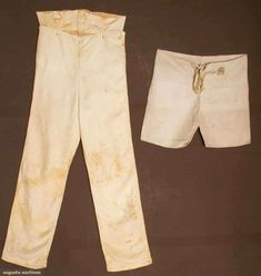 "Two Pair Men's Pants, America, Early 19th century. One pair silk long pants with wide fall front, bone buttons, high waistband with watch pocket, metal weights inside pant hem; a pair of c. 1810 linen ""small clothes"", two inked label patches ""C.F. Cruft"" & ""No. 88""; also one linen remnant inked ""Mr. Cruft's small clothes, 1810"""