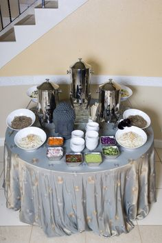 Noodle bar with broths and toppings. On Sari Mist linen. With our buddha head and cool white slanted bowls.