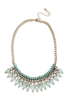 This delicate pastel piece is covered in turquoise pointed gems and clear crystal detail. It is approximately 16 inches in length, with a 3 inch extension.