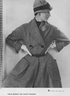 September Vogue 1951    Elise is wearing a black and striped tweed coat which has a small waist and a wide skirt. Hat by Lilly Daché.