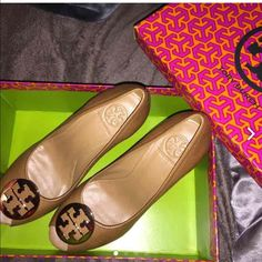Brand new Tory burch wedges! Size 10.5 new in box Super pretty Tory burch royal tan wedges with classic Tory gold logo! Comes with original box and a shopping bag! Nwt!! Tory Burch Shoes