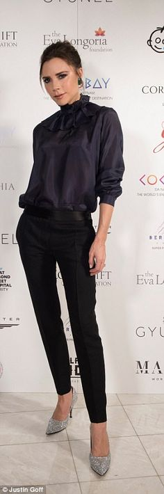 Characteristically chic: Victoria looked lean in her skinny leg trousers...