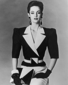 The decade's most prominent silhouette was the one that turned your body into an upside-down triangle. Add a couple giant earrings and a big belt, ...