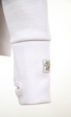 PennyPosh lily logo is embroidered on every left sleeve. The cuffs are made wider and with thumb holes to give a glove like feature After Baby, Cozy Blankets, Cuffs, Gloves, Lily, Yoga, Hoodies, Sleeve, How To Wear