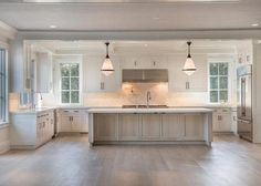 White Kitchen with whitewash island. White Kitchen with whitewash stained kitchen island. #WhiteKitchen #Whitewashisland #WhitewashStainedWood #WhitewashKitchenIsland Michael Davis Design and Construction.