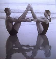 Partner yoga... would be fun!