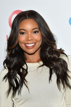 Gabrielle Union curled her long layers in New York City in June 2016.