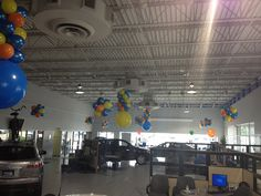 """Mazda Summer - Balloon Man LLC #balloondesigns  #eventballoons - We have put in a tremendous amount of study and development over the years to define the purpose Balloon Man's Showroom Balloon Decoration. When we have asked our customers; """"Why do you use balloons anyway?"""" I get the same response almost every time - """"to make the showroom look more festive""""."""