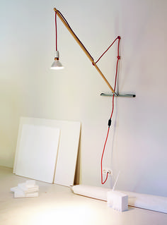 The Yourself lamp, from German firm Team Ingo Maurer, is an elegant fixture constructed from a broomstick and a neoprene squeegee.