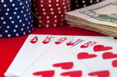 casino game - Poker hand, chips and paper bill representing a casino game.