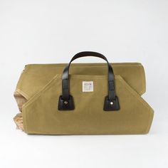 Filson originated as an outfitter for the Klondike Gold Rush in 1897, and has been producing goods for the outdoor enthusiast ever since.  Filson's bags are among their most well-known products, appreciated for their outstanding quality and rugged good looks.  Unlike nylon bags, they only get better with use due to their water resistant heavy weight oiled canvas and bridle leather construction which softens and develops greater character over time. Making the trip from wood pile to fireplace…