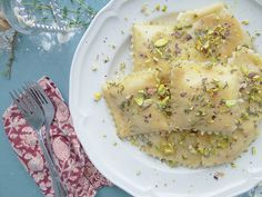 acorn squash ravioli w/ thyme garlic butter & pistachios