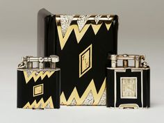 1920s. Rare Art Deco black and eggshell enamel, gold and silver Dunhill lighter and cigarette case.