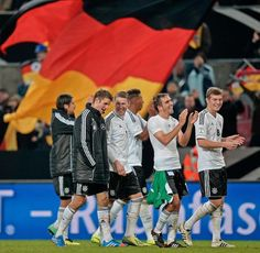Germany players celebrate qualifying for the 2014 World Cup