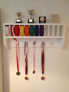 Martial Arts trophies and medals and belt rack.  JUST HAVE TO HAVE THIS FOR MY SON ♥♥♥