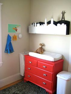 Nice idea... to hang the hamper right by the changing table!