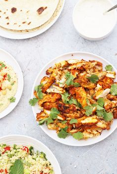 Oven Baked Chicken Shawarma with Garlic Sauce, Tabbouleh, Hummus and Flatbreads