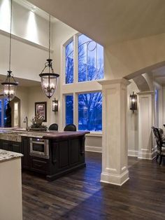 WOW - amazing kitchen.  Love the columns, picture window, the lights, I could go on & on