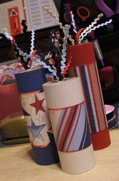 Use paper towel rolls and toilet paper rolls, paint, wrap paper around the middle.  Glue a piece of cardstock on the top, make a small hole and thread the rick rack through.