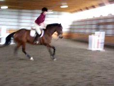 Melissa rides bucking horse in indoor arena. - YouTube