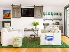 Faux-grass brings the outdoors in // #hgtvmagazine http://www.hgtv.com/design/decorating/design-101/a-rhode-island-home-thats-made-for-visitors-pictures?soc=pinterest