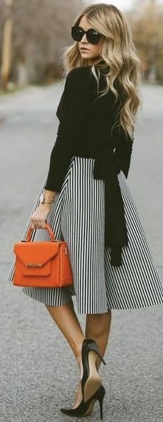 Stitch Fix Fashion 2017! Ask your stylist for something like this in your next fix, delivered right to your door! #sponsored #StitchFix Business attire, black sweater, striped skirt bow on the back. Orange purse.